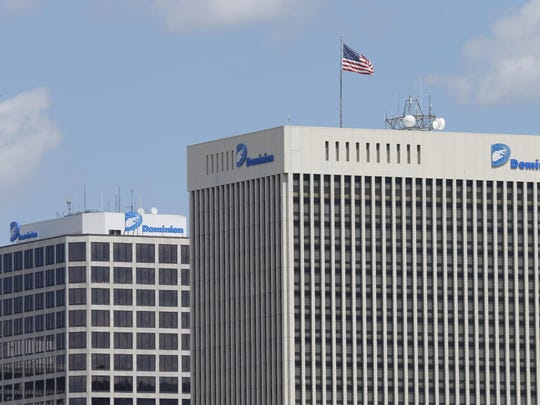ADVANCE FOR RELEASE SATURDAY, AUGUST 22, 2015 This Tuesday April 28,2015 photo shows two Dominion Power buildings in downtown Richmond, Va., Tuesday, April 28, 2015. Virginia residents have been billed tens of thousands of dollars to pay for donations the state's most powerful electricity company has made to politically connected charities. (AP Photo/Steve Helber)