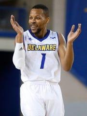 Delaware's Chivarsky Corbett celebrates a Blue Hen run in the first half against Delaware State at the Bob Carpenter Center Friday.