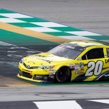 Matt Kenseth crosses the finish line to win the NASCAR Quaker State 400 race at Kentucky Speedway in June.