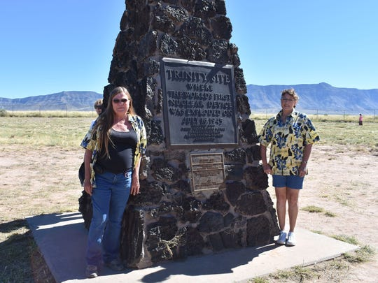 Cathy Harper, Marketing and Public Relations Director of the New Mexico Museum of Space History and Administrative Assistant Kelly Ward take a moment to appreciate the monument.