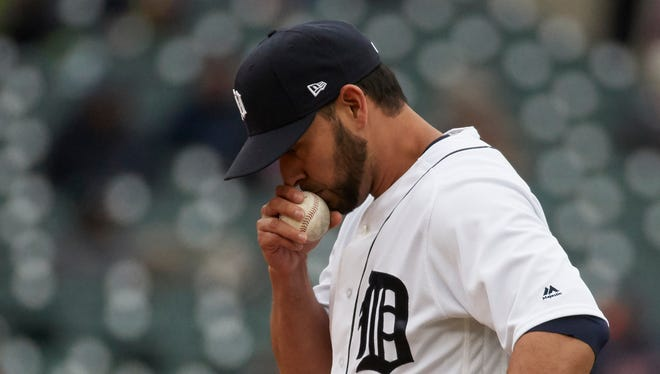 Apr 13, 2017; Detroit, MI, USA; Detroit Tigers pitcher Anibal Sanchez kisses the ball during the fifth inning against the Minnesota Twins at Comerica Park.