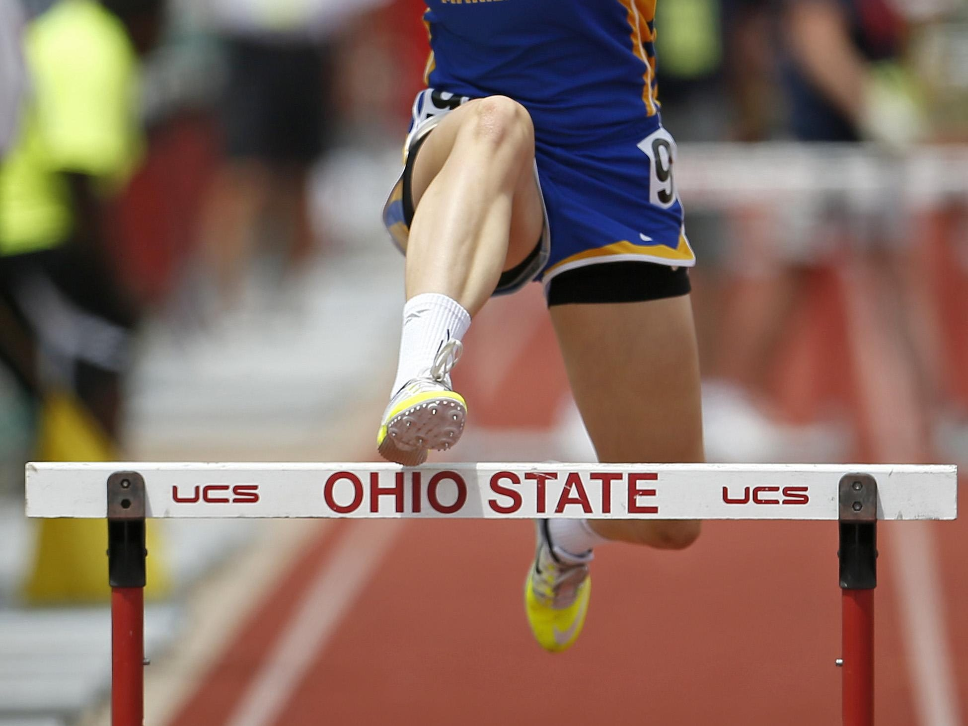 Mariemont's Carson Fields crosses the final hurdle in the 300-meter hurdles event at the OHSAA Division II state finals. Fields finished seventh with a time of 45.87 seconds.