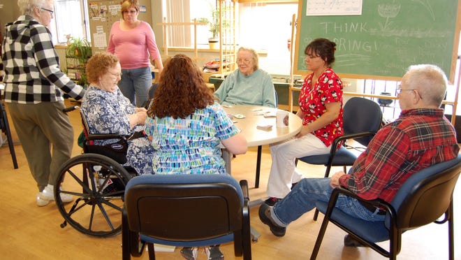 Legacy Club members play cards together at Perennial Park, in this file photo. While the center remains closed,  respite care workers have been offering some in-home respite care to combat feelings of isolation.