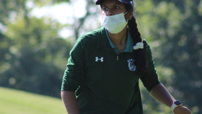 Anjali Mishra thinks about her next shot during the first of the four Suburban League tournaments Thursday. Aurora won the nine-team a.m. flight at the Lady Rough Rider Invitational Saturday at The Fairways at Twin Lakes in Kent.