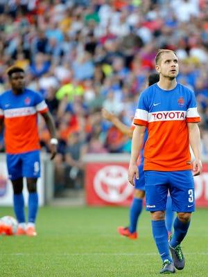 FC Cincinnati's Tyler Polak looks at the scoreboard after Louisville City FC scored its third goal in the first half.