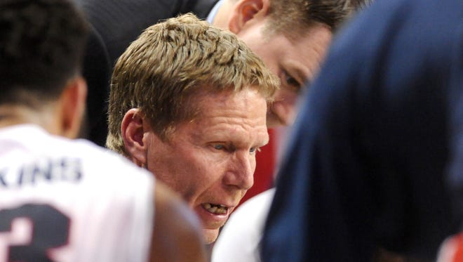 Gonzaga Bulldogs head coach Mark Few huddles with his team during a game against the Akron Zips during the second half at McCarthey Athletic Center. The Bulldogs won 61-43.