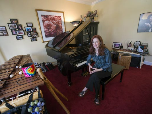 Internationally known pianist Robin Spielberg is shown at her home in New Freedom. She will be releasing her 17th album April 28 and will bring her national tour home to York at the Pullo Center April 18.