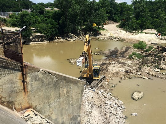 Demolition of the 105-year-old Ballville Dam began in July 2018 in this News-Messenger file photo.