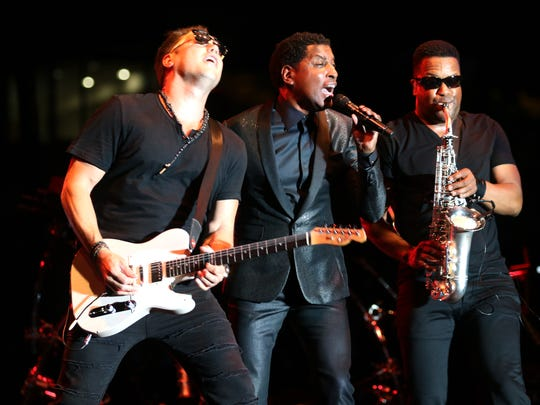 "Kenneth ""Babyface"" Edmonds and his band performs during the Cincinnati Music Festival at Paul Brown Stadium Friday July 22, 2016."