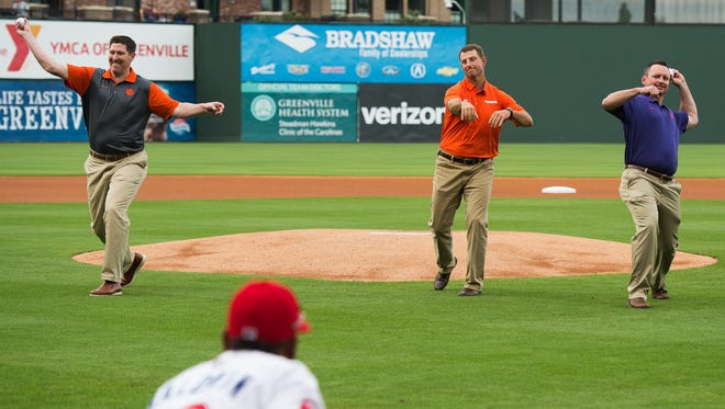 Clemson University basketball head coach Brad Brownell, football head coach Dabo Swinney, and baseball head coach Monte Lee throw the opening pitch at a Greenville Drive game after the Prowl & Growl at Fluor Field on Wednesday, May 3, 2017.