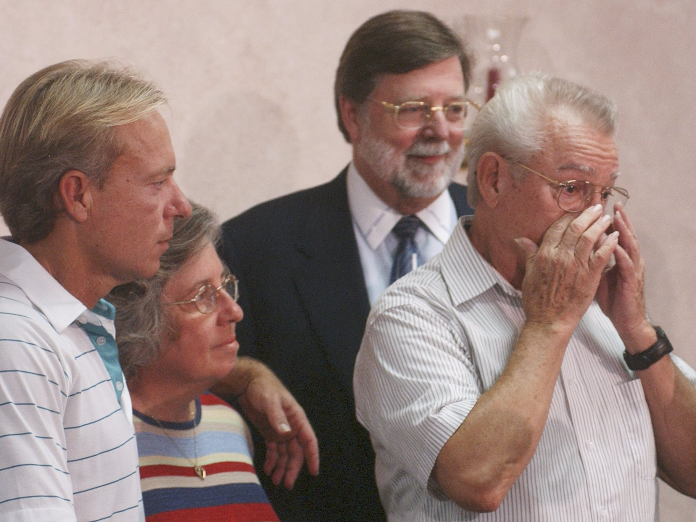 Tears of joy. Gary Dedge, right, becomes emotional