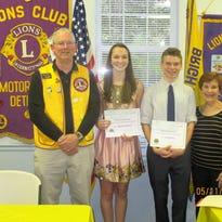 From left are Lion John Conely, scholarship winner Madelynn Stuenkel, scholarship winner Jack Wisbiski and Joseph Piersante's daughter, Jana Cordon.