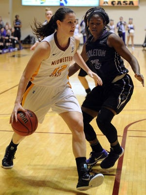 Lauren Roberts/Times Record News Midwestern State's Jennifer Sissel (12) drives to the basket in the game against Tarleton Wednesday, Jan. 13, 2016, at D.L. Ligon Coliseum. MSU won it's second Lone Star Conference game against TSU 56-52.