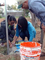 In this file photo, teens got a lesson in mixing concrete during Teens Make a Difference Day. The event, now called Together We Can Make a Difference, will be held Oct. 26, 2019, with volunteers at 65 different locations in the Wichita Falls area.