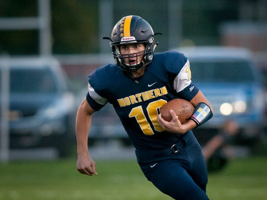 Port Huron Northern's Matthew Baravik runs the ball during a football game Friday, Oct. 7, 2016 at Memorial Stadium in Port Huron.