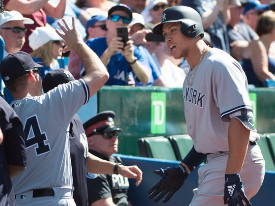Jul 7, 2018; Toronto, Ontario, CAN; New York Yankees right fielder Aaron Judge (99) celebrates in the dugout after hitting a home run during the first inning against the Toronto Blue Jays at Rogers Centre.