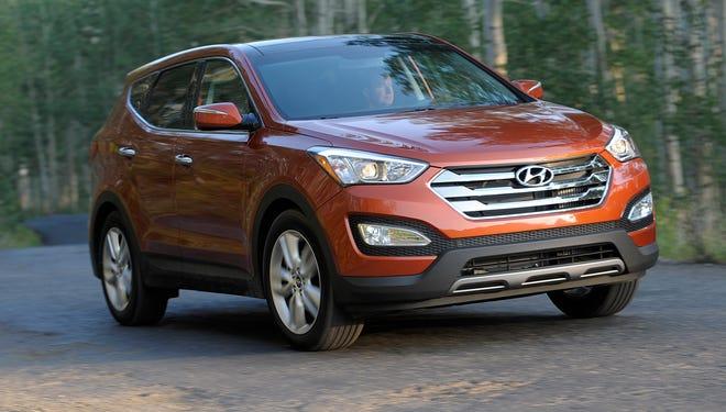 A 2013 Hyundai Santa Fe Sport.