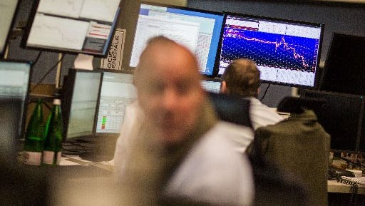 Traders work at the stock exchange in Frankfurt am Main, central Germany, on September 18, 2015.