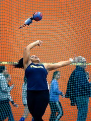 Webster Thomas junior Monique Hardy continues to reset Section V's record for the girls weight throw.