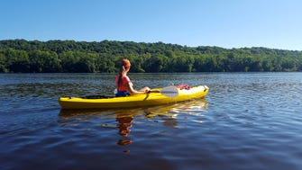 Courtney Lewis paddles down the St. Croix River north of St. Croix Falls. The river is part of the St. Croix National Scenic Riverway.