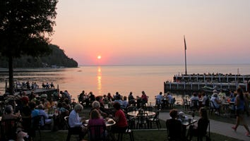 Sunset view from Fuzzy's Waterfront Bar & Grill listed for sale July 12, 2018.