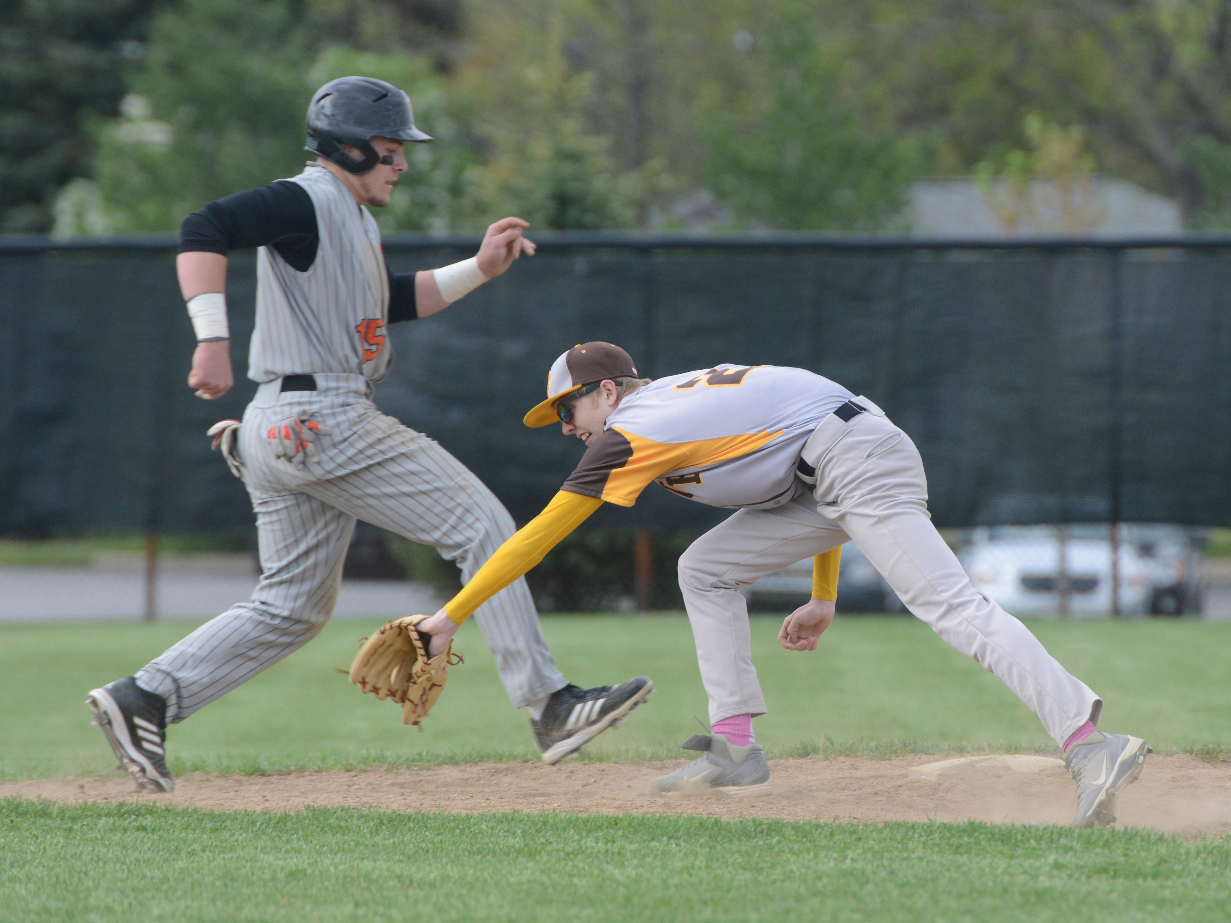 Gibsonburg's Madison Jaso is safe past Old Fort's Hootie Cleveland in the second inning.