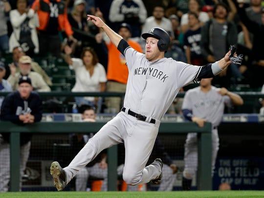 New York Yankees' Todd Frazier begins a slide as he