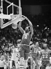 Philadelphia 76ers' Moses Malone slams home two of his 24 points in a playoff game against the Lakers, in Los Angeles, Calif., on June 1, 1983. The Sixers went on to sweep the Lakers four games straight to win the NBA championship.