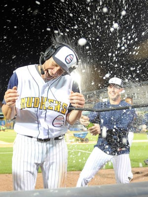 Mike Hessman gets sprayed with champagne after setting the minor league home run record on Aug. 3 in Toledo.