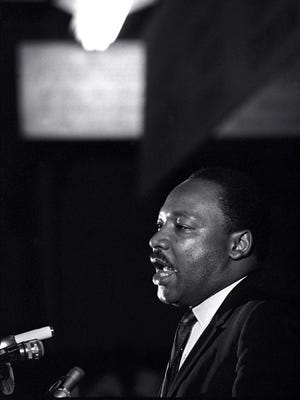 In this April 3, 1968, file photo, Dr. Martin Luther King Jr. makes his last public appearance at the Mason Temple in Memphis, Tenn. The following day King was assassinated on his motel balcony.