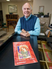 Composer Allen Pote poses with his Christmas cantata