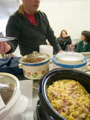 A pot of mac and cheese with ham at the Georgia Town Meeting.
