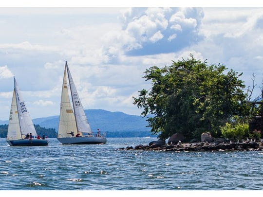Boats round Diamond Island and head upwind for the finish during the Diamond Island Regatta on August 23.