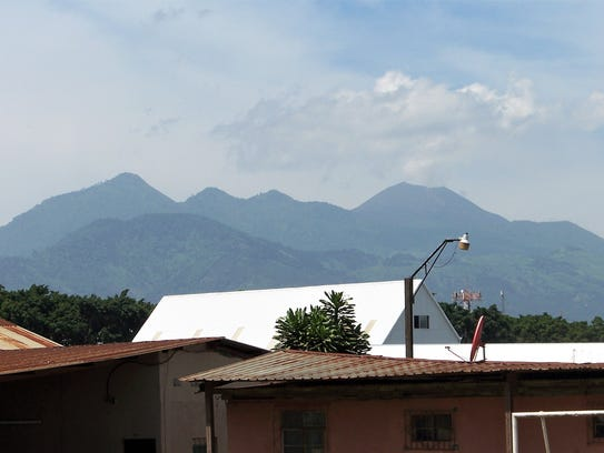 Two volcanoes, Agua and Pacaya, can be seen from New Life Children's Home in Villa Nueva, Guatemala. Farther away is Fuego, the volcano that erupted this week and has killed dozens.