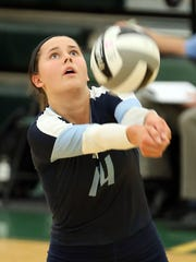 Mount Notre Dame's Margo Wolf gets a dig during their 2013 volleyball game against Ursuline.