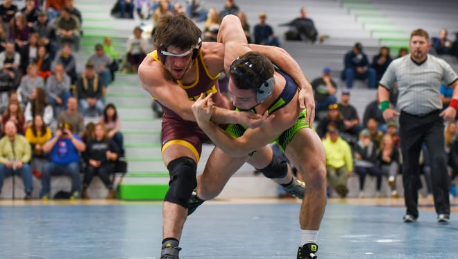 University of Providence wrestler Casey Dobson, shown battling MSU-Northern's Brandon Weber in a 2018 match, is ranked fourth in the NAIA rankings going into this weekend's Missouri Valley Invitational Tournament.