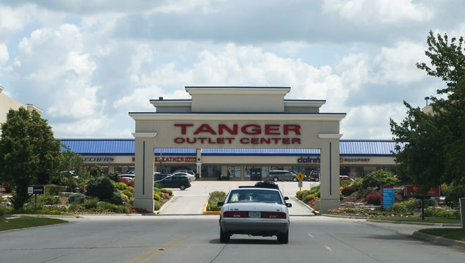 Motorists stop at the Tanger Outlet Mall along Interstate Highway 80 on Wednesday, July 16, 2014, in Williamsburg, Iowa.