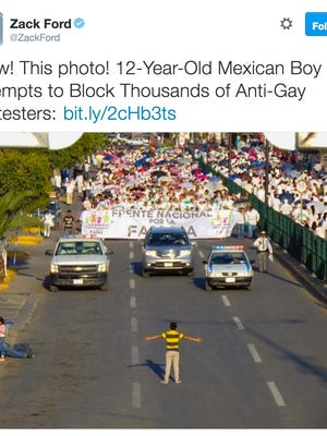 12-year-old boy attempts to block anti-gay protesters.