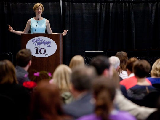 Editor Alexa Stanard, a Port Huron native, addresses the audience during the Best of Michigan award ceremony hosted by ÒMichigan Meetings and EventsÓ magazine Thursday, May 14, 2015 at the Blue Water Convention Center in Port Huron.