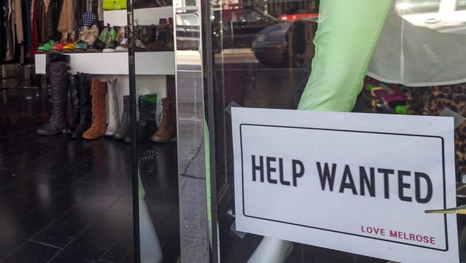"""The July unemployment rate for Indiana was 4.6   percent, down from 4.8 percent in June, the Indiana Department of Workforce Development said Friday. A """"help wanted"""" sign is posted on the front window of a clothing boutique."""