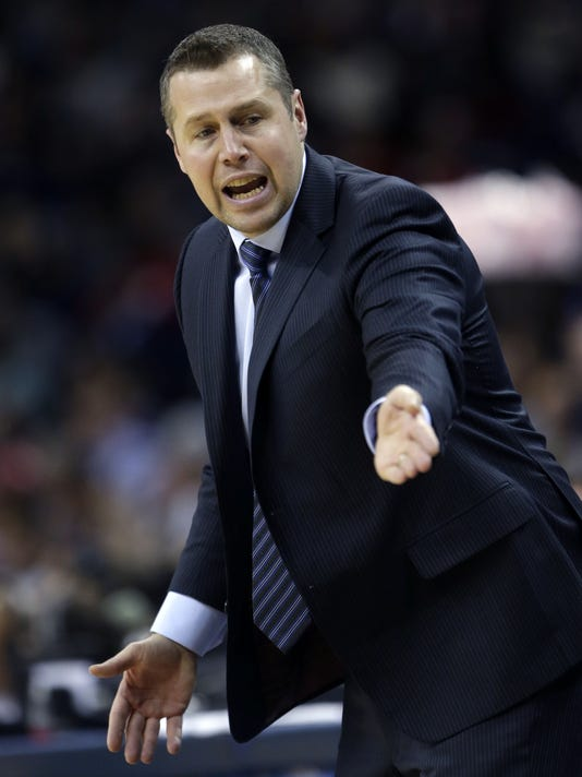 Memphis Grizzlies head coach David Joerger complains to officials in the first half of an NBA basketball game against the New Orleans Pelicans in New Orleans, Friday, Jan. 9, 2015. (AP Photo/Gerald Herbert)