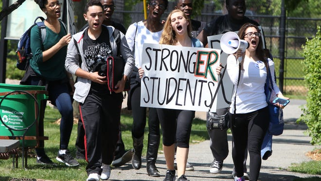 Students from Ramapo High School march to Memorial Park in Spring Valley on May 20, to protest the school board and conditions in their school.