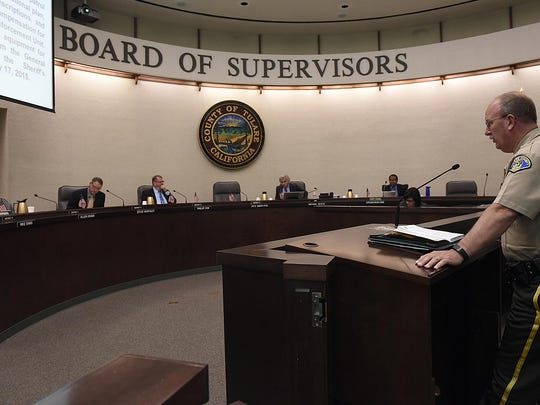 Tulare County Sheriff's Capt. Keith Douglass addresses the county Board of Supervisors on Tuesday to request the transfer of county Lake Patrol boats and equipment from the county General Services Division to the Sheriff Department.