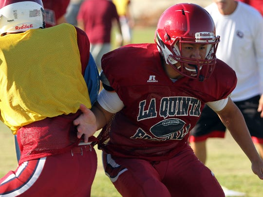 La Quinta High School's Omar Valenzuela works through linebacker drills during an early morning practice earlier this season. Valenzuela has been named Defensive Player of the Year by the Desert Valley League.