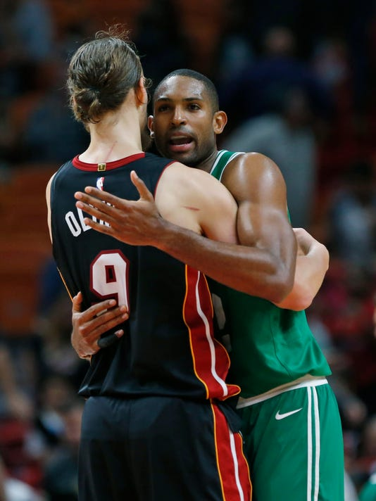 Miami Heat forward Kelly Olynyk (9) and Boston Celtics center Al Horford congratulate each other after the Celtics defeated the Heat 96-90 during an NBA basketball game, Saturday, Oct. 28, 2017, in Miami. (AP Photo/Wilfredo Lee)