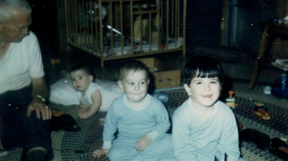 """Guthrie """"Papa"""" Gentry and three of his grandsons, including Jeffrey Gentry (front) playing on the floor  around 1971."""
