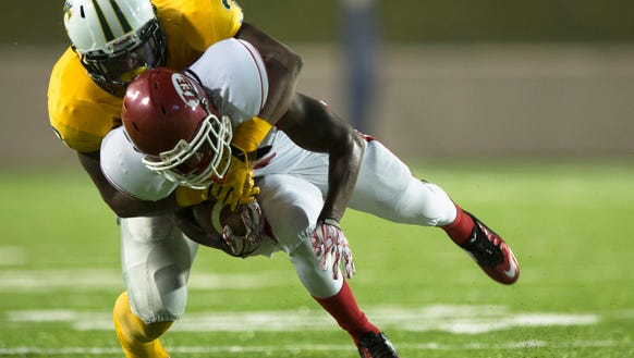 Lee wide receiver Jonah Garrison (4) is tackled by