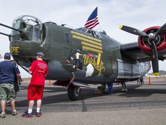 People look at a B-24 Liberator World War II bomber that is part of the Wings of Freedom Tour, now at Phoenix Deer Valley Airport, on April 11, 2017. Four rare warbirds are on display through April 13, 2017.