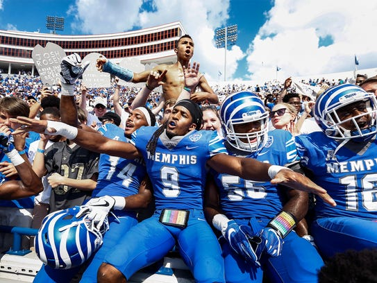 University of Memphis Jamil Collins (middle) celebrate