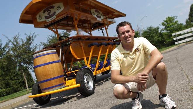 Scott Benningfield, shown in this July 2, 2012, photo, is owner of The Thirsty Pedaler, a 15-person pedal-powered vehicle. It has room in the front for a keg.